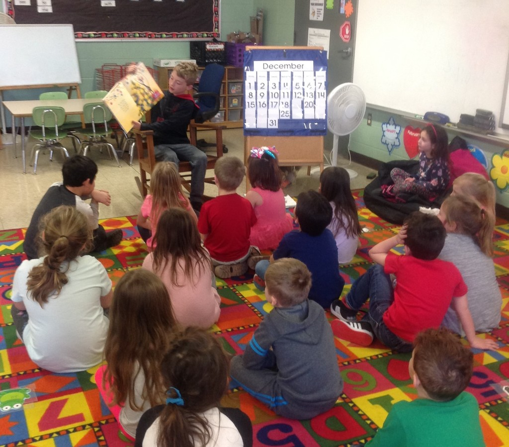 3rd graders read to kindergarten class.